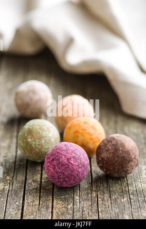 Sweet truffle balls on wooden table. - Stock Photo