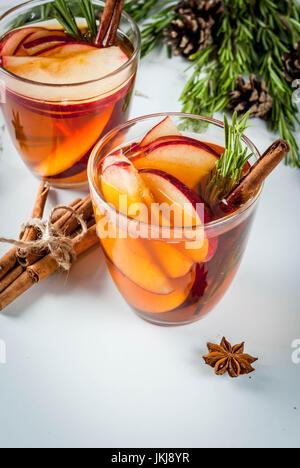 Christmas, Thanksgiving drinks. Autumn, winter cocktail grog, hot sangria, mulled wine - apple, rosemary, cinnamon, - Stock Photo