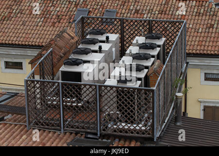 Air conditioning units on top of building. Italy - Stock Photo