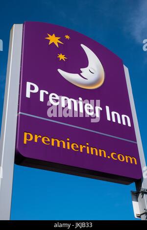 YORK, UK - JULY 17TH 2017: The Premier Inn logo outside their hotel near Leeds, UK, on 17th July 2017. - Stock Photo