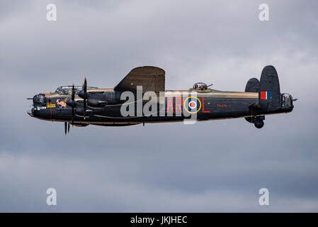 RAF BBMF Avro Lancaster bomber in solo flypast after leading the Thompson Formation at the Royal International Air - Stock Photo