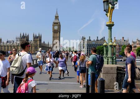 Tourists on Westminster Bridge, London, England, UK - Stock Photo
