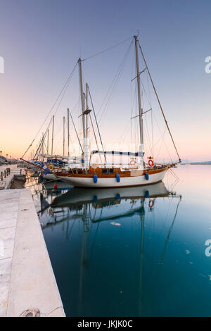 Sail boats in the harbour of Volos city as seen early in the morning. - Stock Photo