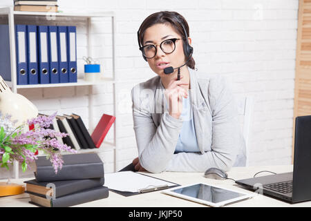 Call Center operator works at the computer in the Office - Stock Photo