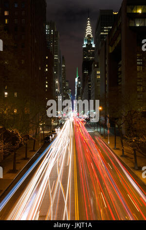 East 42nd Street At Night From Tudor City With Traffic Headlights On Road With Chrysler Building In Background, - Stock Photo