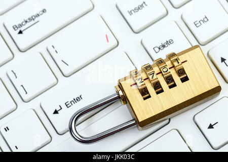 computer and online security with keyboard and padlock - Stock Photo