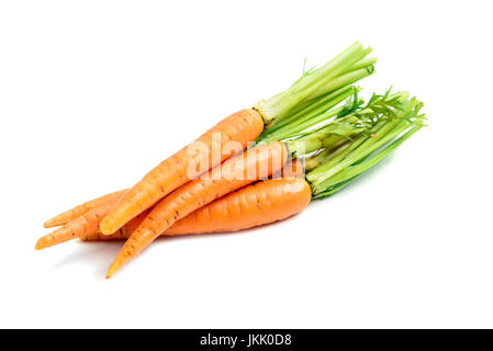Heap of fresh carrots with stems isolated on white background - Stock Photo