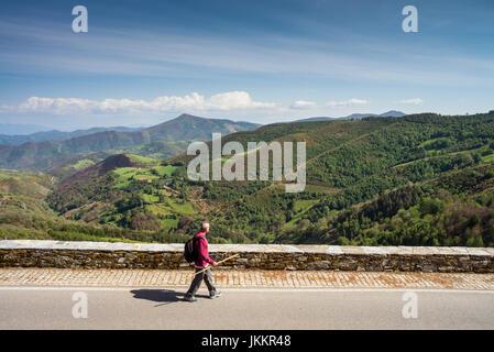 pilgrim in the landscape near of the O Cebreiro, Galicia, Spain, Europe. Camino de Santiago. - Stock Photo