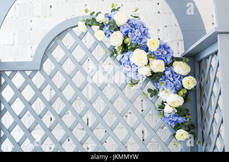 Blue delicate decorative wood panel in classical interior. Boudoir room. Retro folding screen with flowers. Vintage - Stock Photo
