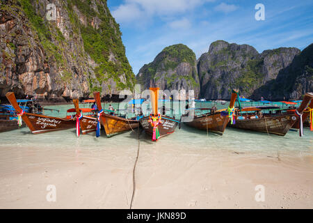 KRABI, THAILAND - DECEMBER 4 : Colorful long tail boats at beautiful beach on a background of blue sky and azure - Stock Photo