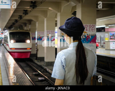 Tokyo, Japan - May 20, 2017. A young woman working at the railway station in Tokyo, Japan. Railways are the most - Stock Photo