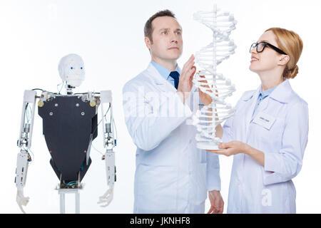 Inspired extraordinary scientists seeing future of robotics in genes - Stock Photo