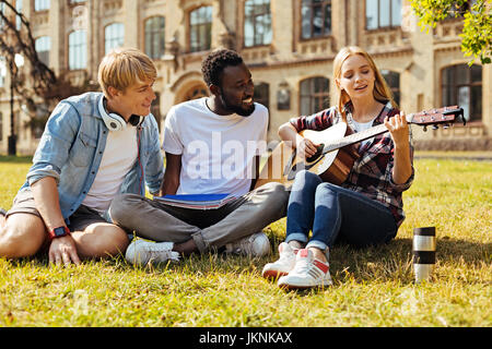 Gifted bright woman playing guitar - Stock Photo