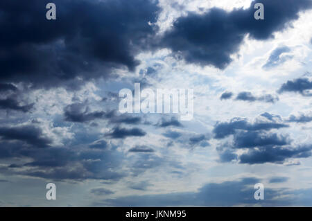 A blue sky with storm clouds. Before the rain.; - Stock Photo