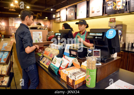 (170724) -- KUALA LUMPUR, July 24, 2017 (Xinhua) -- Logos of Alipay are seen inside a shop in Kuala Lumpur, Malaysia, - Stock Photo
