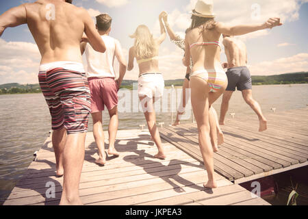 People about to jump into the water - Stock Photo