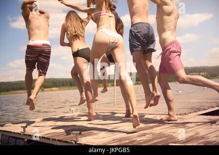 Jumping to water to cool down - Stock Photo