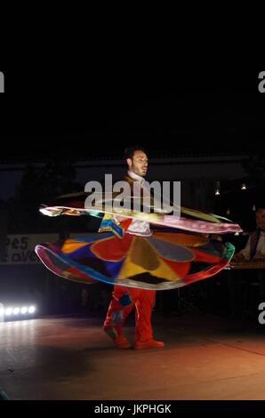 Sufi Dancer performing at Mercado das Culturas à luz das Velas festival in Lagoa, Algarve, Portugal. Travel and - Stock Photo