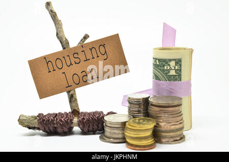 Coins and money with  housing loan label. Financial concept. - Stock Photo