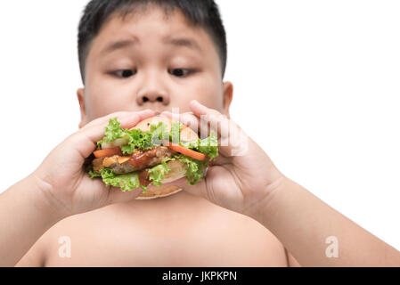 pork hamburger on obese fat boy hand background isolated on white, unhealthy food, junk food or fast food - Stock Photo