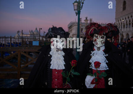 male and female Baute Mask wearers in the Carnival of Venice, Italy - Stock Photo