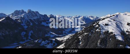 Snow covered mountains, winter scene in Switzerland. - Stock Photo
