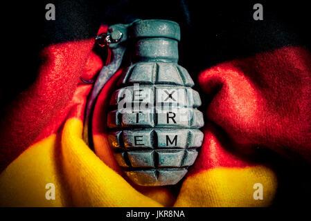 Grenade in Germany flag, extremism in Germany, Handgranate in Deutschlandfahne, Extremismus in Deutschland - Stock Photo