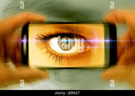 Eye in smartphone camera, symbolic photo for nosy parkers, Auge in Smartphone-Kamera, Symbolfoto für Gaffer - Stock Photo