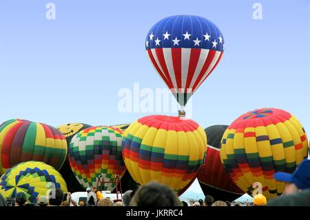 Balloons on a misty morning - Stock Photo