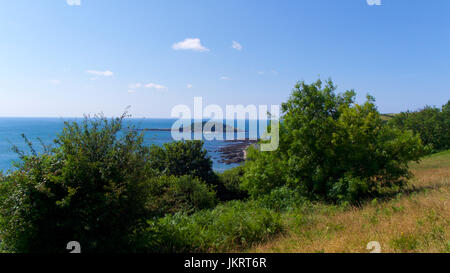 View from East Looe towards Looe Island (St George's Island), Cornwall, UK - Stock Photo