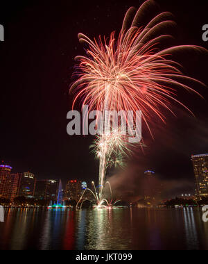 Fourth of July fireworks at Lake Eola Park in downtown Orlando, Florida. - Stock Photo