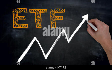 ETF and graph is written by hand on blackboard. - Stock Photo