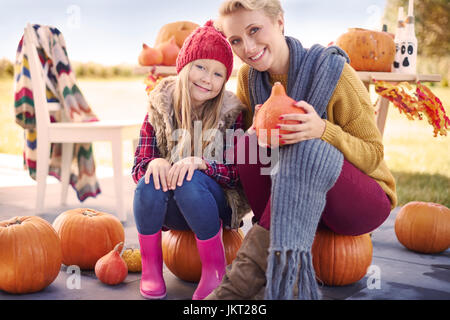 Portrait of happy family in the garden - Stock Photo