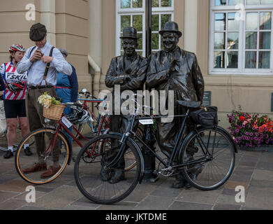 Bronze statue of Laurel and Hardy during a vintage cycling event in Ulverston, Cumbria - Stock Photo