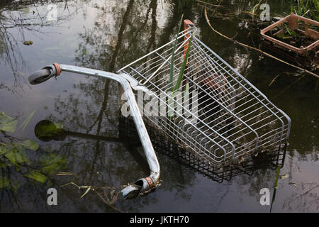 Abandoned Shopping Trolley in water - Stock Photo