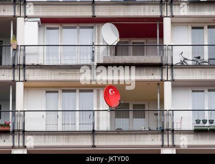 Turkish flag on satellite dish at social housing apartment block at Pallasseum on Pallastrasse in Schoeneberg district - Stock Photo