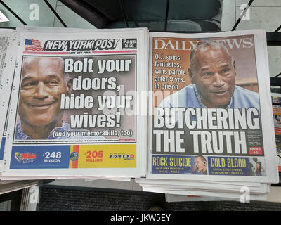 The headlines of New York tabloid newspapers on Friday, July 21, 2017 report O.J. Simpson being granted parole after - Stock Photo