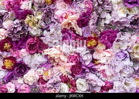 Flower texture background for wedding scene. Roses, peonies and hydrangeas, artificial flowers on the wall. - Stock Photo