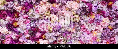 Flower texture background for wedding scene. Roses, peonies and hydrangeas, artificial flowers on the wall. Banner - Stock Photo