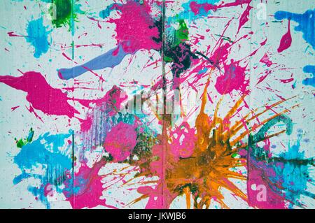 Abstract multicolored paint on wood panel background - Stock Photo
