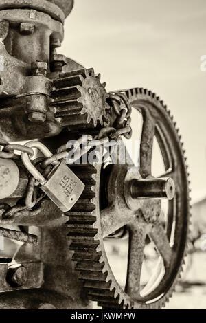 National Park Service padlock on antique pump at Castalon historic district in Big Bend National Park - Stock Photo