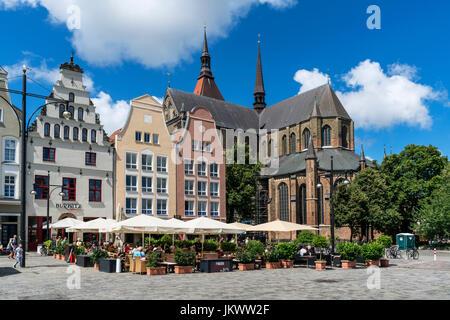 new market, street cafe, St Marys church , Marienkirche, Rostock , Mecklenburg-Vorpommern, East Germany - Stock Photo