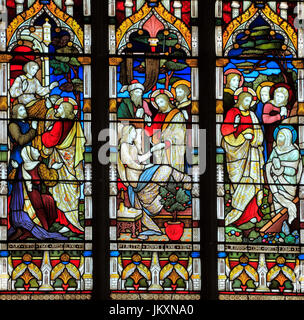 Miracles of Jesus, Raising the Dead, Say Unto Thee Arise, Talitha Koum, Lazarus come Forth, stained glass window - Stock Photo