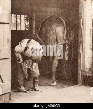 An English farrier at work in 1932 - Stock Photo