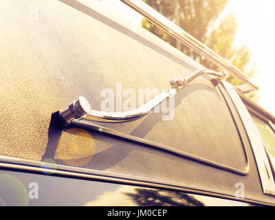 Detail of an old American funeral car in the evening sun, lifestyle background retro film stylized - Stock Photo