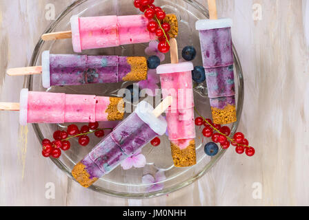Frozen berry and ginger nut yogurt lolly pops - top view - Stock Photo