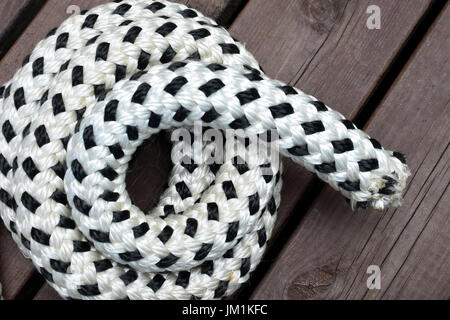Rope on brown deck - Stock Photo