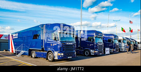 The 6 HGVs that support the 3 cars - Stock Photo