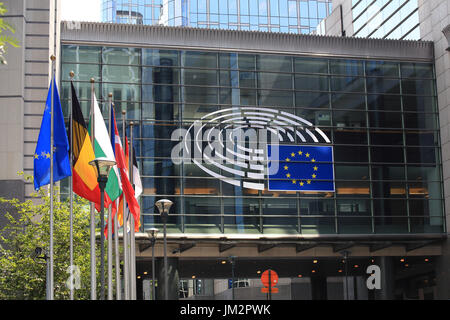 Brussels, Belgium - July 17, 2017: European Parliament building on a sunny day. Emblem of the European Parliament - Stock Photo