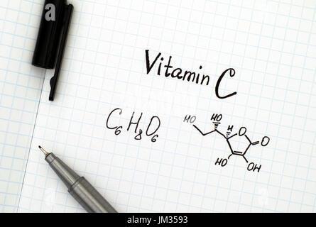 Chemical formula of Vitamin C with black pen.